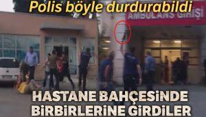 Hastane bahçesinde polisin havaya ateş açarak kavga edenleri ayırdığı olay kamerada